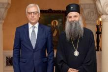 <p>Патријарх Порфирије и Александар Грушко</p>